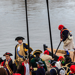 Washington Crossing, PA, USA - December 25, 2015: Reenactors aboard a Durham boat prepare to leave Pennsylvania and cross the Delaware River during the annual Christmas Day reenactment.