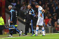 A physic gives the thumbs up as Angel Di Maria of Argentina limps to the sideline following treatment - Argentina vs. Portugal - International Friendly - Old Trafford - Manchester - 18/11/2014 Pic Philip Oldham/Sportimage