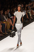 Black, gray and white print pants and a gray and black top.
