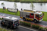 Members of the Basque Police and firefighters rescue the body of Yaya from the bidasoa river. Irun (Basque Country). May 22, 2021.  Yaya, a 28 years old migrant from Côte d'Ivoire tried to cross the Spanish-French border swimming across the Bidasoa river.  As police controls on the two bridges crossing the border from Irun increased, migrants started using alternative routes  and some tries to cross the border swimming in this area.  (Gari Garaialde / Bostok Photo)