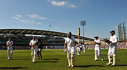 South Africa's Hashim Amla leaves the pitch for tea with a guard of honor at 311 not out during the Investec first test match at the Kia Oval, London.