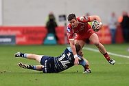 DTH Van der Merwe of the Scarlets breaks past the tackle from Dan Fish of the Cardiff Blues. Guinness Pro12 rugby match, Scarlets  v Cardiff Blues at the Parc y Scarlets in Llanelli, West Wales on Saturday 2nd April 2016.<br /> pic by  Andrew Orchard, Andrew Orchard sports photography.