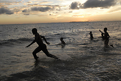 Children play on the beach of Zanzibar in Tanzania.