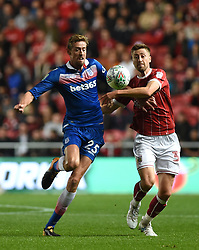 Stoke City's Peter Crouch (left) and Bristol City's Jens Hegeler battle for the ball during the Carabao Cup, third round match at Ashton Gate Stadium, Bristol.