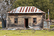 Dilapidated rundown old wooden farm house in paddock near Dunedoo, New South Wales, Australia <br />