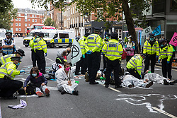 Climate activists from Extinction Rebellion wearing hazmat suits protest against roadbuilding by occupying the street outside the Department of Transport on 3 September 2020 in London, United Kingdom. Extinction Rebellion activists are attending a series of September Rebellion protests around the UK to call on politicians to back the Climate and Ecological Emergency Bill (CEE Bill) which requires, among other measures, a serious plan to deal with the UK's share of emissions and to halt critical rises in global temperatures and for ordinary people to be involved in future environmental planning by means of a Citizens' Assembly.