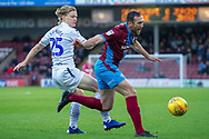 Wycombe Wanderers forward Alex Samuel (25) fouls Scunthorpe United defender Rory McArdle (23) during the EFL Sky Bet League 1 match between Scunthorpe United and Wycombe Wanderers at Glanford Park, Scunthorpe, England on 29 December 2018.