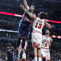 26 March 2012: Denver Nuggets center JaValee McGee (34) goes for the dunk over Chicago Bulls center Joakim Noah (13) during the Denver Nuggets 108-91 victory over the Chicago Bulls at the United Center, Chicago, Illinois, USA. NOTE TO USER: User expressly acknowledges and agrees that, by downloading and or using this photograph, User is consenting to the terms and conditions of the Getty Images License Agreement. Mandatory Credit: 2012 NBAE (Photo by Chris Elise/NBAE via Getty Images)