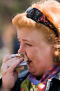 Moscow, Russia, 26/04/2007..Russians visit Boris Yeltsin's grave to pay their last respects after Novodevichy Cemetery was  reopened to the public on the day following the former Russian President's funeral. A woman weeps at the graveside..
