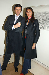 MICHEL BERGER-SANDHOFER and JUDITH HESS at an exhibition of art entitled 'Royal Academicians in China: 2003-2005' held at the Royal Academy of Arts, Burlington House, Piccadilly, London on 11th January 2005.<br /><br />NON EXCLUSIVE - WORLD RIGHTS