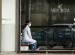 A health worker woman takes a break in Athens, Greece on March 23, 2020 as the country is battling hard to control the spread of the COVID-19, the novel coronavirus. Greek Prime Minister announced a ban on public movement starting at 06:00 am on March 23, 2020 to stem the spread of the global coronavirus pandemic in Greece.<br /> <br /> Pictured: <br /> Dimitris Lampropoulos  | EEm date