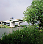 The Thelwall motorway viaduct crossing the Manchester Ship Canal and river Mersey just west of Warrington. The Mersey is a river in north west England which stretches for 70 miles (112 km) from Stockport, Greater Manchester, ending at Liverpool Bay, Merseyside. For centuries, it formed part of the ancient county divide between Lancashire and Cheshire.