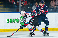 KELOWNA, BC - MARCH 7: Logan Barlage #27 of the Lethbridge Hurricanes stick checks Mark Liwiski #9 of the Kelowna Rockets during first period at Prospera Place on March 7, 2020 in Kelowna, Canada. (Photo by Marissa Baecker/Shoot the Breeze)