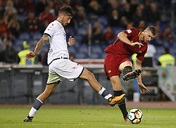 October 25, 2017 - Rome, Italy - Roma Edin Dzeko, right, is challenged by Crotone Federico Ceccherini during the Serie A soccer match between Roma and Crotone at the Olympic stadium. (Credit Image: © Riccardo De Luca/Pacific Press via ZUMA Wire)