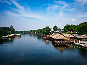 "09 JANUARY 2019 - KANCHANABURI, THAILAND: Looking north up the River Kwai from the famous ""Bridge On the River Kwai"" in Kanchanaburi. Hundreds of thousands of Asian slave laborers and Allied prisoners of war died in World War II constructing the ""Death Railway"" between Bangkok and Rangoon (now Yangon), Burma (now Myanmar) for the Japanese during World War II.  The bridge is now one of the most famous tourist attractions in Thailand.      PHOTO BY JACK KURTZ"