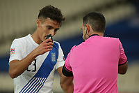 ATHENS, GREECE - OCTOBER 14: Referee Roi Reinshreiber and Dimitris Giannoulisof Greece during the UEFA Nations League group stage match between Greece and Kosovo at OACA Spyros Louis on October 14, 2020 in Athens, Greece. (Photo by MB Media)