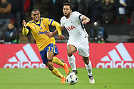 Mousa Dembele of Tottenham Hotspur (19) battles for possession with Juventus attacker Douglas Costa (11) during the Champions League match between Tottenham Hotspur and Juventus FC at Wembley Stadium, London, England on 7 March 2018. Picture by Matthew Redman.