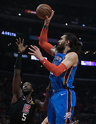 March 8, 2019 - Los Angeles, California, United States of America - Montrezl Harrell #5 of the Los Angeles Clippers tries to block Steven Adams #12 of the Oklahoma Thunder during their NBA game on Friday March 8, 2019 at the Staples Center in Los Angeles, California. Clippers defeat Thunder, 118-110.  JAVIER ROJAS/PI (Credit Image: © Prensa Internacional via ZUMA Wire)