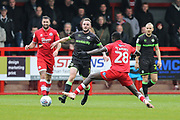 Forest Green Rovers Carl Winchester(7) goes past Panutche Camara of Crawley Town during the EFL Sky Bet League 2 match between Crawley Town and Forest Green Rovers at The People's Pension Stadium, Crawley, England on 6 April 2019.