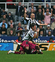 Photo: Andrew Unwin.<br /> Newcastle United v Bolton Wanderers. The Barclays Premiership. 15/10/2006.<br /> Newcastle's Emre (middle) pleads for leniency as his challenge leaves Bolton's El-Hadji Diouf (bottom) on the floor.