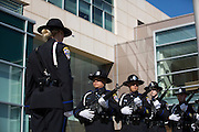 The Milpitas Police Department Honor Guard performs a 21-Gun Salute during the City of Milpitas Memorial Day ceremony at Milpitas City Hall in Milpitas, California, on May 30, 2016. (Stan Olszewski/SOSKIphoto)