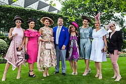 Ascot, UK. 20 June, 2019. Racegoers wearing hats made from their hair attend Ladies Day at Royal Ascot.