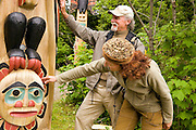 USA, Alaska,Clark and Nina Wagaman explore the totems at Saxman Totem Park two miles south of Ketchikan on Revillagigedo Island.MR