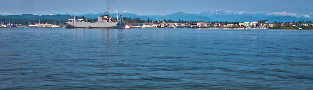 USNS BRITTIN   (T-AKR 305).Large, Medium-Speed Roll-on/Roll-off Ship arriving at Puget Sound Naval Shipyard in Bremerton, Washington Also seen in the foreground is a US Navy Tug....