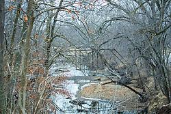 An old steel bridge in disrepair still spans the Kickapoo Creek near Waynesville Illinois