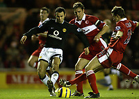 The FA Barclays Premiership<br />1 January 2005, The Riverside, Stadium, Middlesbrough<br />Middlesbrough v Manchester United<br />Manchester United's Ryan Giggs scores the second goal despite the attentions of Middlebrough's Gareth Southgate and Colin Cooper<br />Pic Jason Cairnduff/Back Page Images