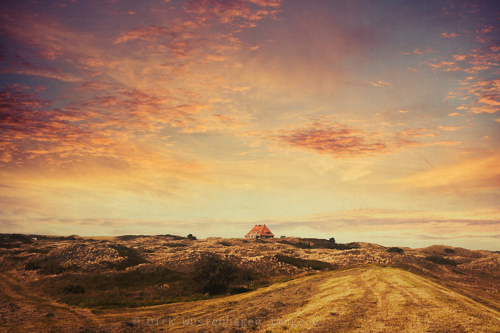 Single house in the dunes on the island Spiekeroog, Germany.<br /> I replaced the sky in Photoshop. A variety of skies you can find here:<br /> https://www.dirkwuestenhagenimagery.de/gallery/Sky-Replacements/G00000dLK4IzD0qs/C0000KEq6byQIWcQ