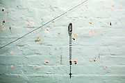 A crucifix hangs on the wall of a cell on Benbow wing inside HMP/YOI Portland, a resettlement prison with a capacity for 530 prisoners. Dorset, United Kingdom.