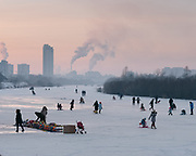 People come play on the ice of the Tuul river, on the edge of the city, especially on week ends, to escape the city air pollution.<br /> Mongolia