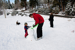 California, Lake Tahoe: Child makes a snow man at  North Lake Tahoe Regional Park.  Photo copyright Lee Foster.  Photo # cataho107553