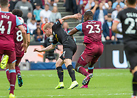 Football - 2019 / 2020 Premier League - West Ham United vs. Manchester City<br /> <br /> Issa Diop (West Ham United) pushes over Kevin De Bruyne (Manchester City) as he tries to break past at the London Stadium<br /> <br /> COLORSPORT/DANIEL BEARHAM