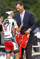 11.09.2011, Madrid,  ESP, LA VUELTA 2011, Finish, im Bild Juan Jose Cobo (l) gives his winner's jersey to Felipe de Borbon, Prince of Asturias.September 11,2011. EXPA Pictures © 2011, PhotoCredit: EXPA/ Alterphoto/ Paola Otero +++++ ATTENTION - OUT OF SPAIN/(ESP) +++++