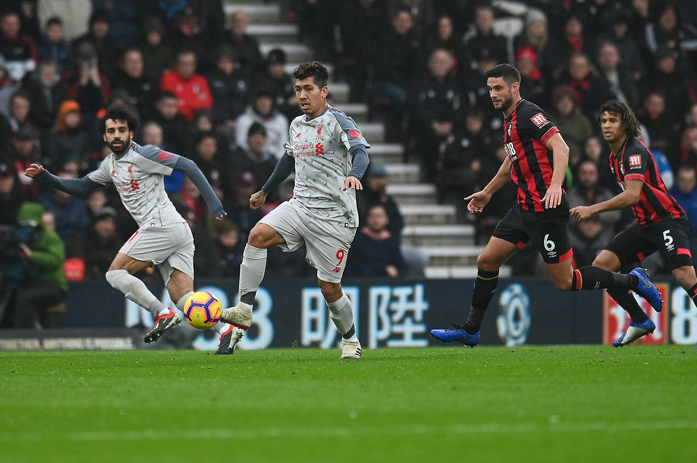 Liverpool's Roberto Firmino (center) under pressure from Bournemouth's Lys Mousset (right) <br /> <br /> Photographer David Horton/CameraSport<br /> <br /> The Premier League - Bournemouth v Liverpool - Saturday 8th December 2018 - Vitality Stadium - Bournemouth<br /> <br /> World Copyright © 2018 CameraSport. All rights reserved. 43 Linden Ave. Countesthorpe. Leicester. England. LE8 5PG - Tel: +44 (0) 116 277 4147 - admin@camerasport.com - www.camerasport.com