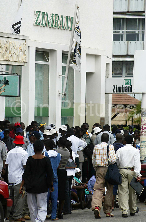 A queue outside Zimbank in Mutari, Zimbabwe. People concerned about their savings queue to withdraw their cash amidst fears of a banking collapse.