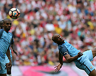 Vincent Kompany of Manchester city in action. The Emirates FA Cup semi-final match, Arsenal v Manchester city at Wembley Stadium in London on Sunday 23rd April 2017.<br /> pic by Andrew Orchard,  Andrew Orchard sports photography.<br /> contact and payments to Andrew Orchard, 2 Old Vicarage close,