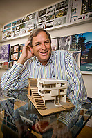 Kenneth Lee poses with a model of a house he designed at Kenneth Lee Architecture in Encino, CA. May 28, 2008.   Photo by David Sprague