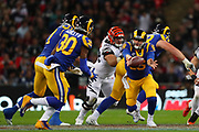 Rams quarterback Jared Goff #16 throws a pass to running back Todd Gurley #30 during the NFL game between Cincinnati Bengals and LA Rams at Wembley Stadium in London, United Kingdom. 27 October 2019