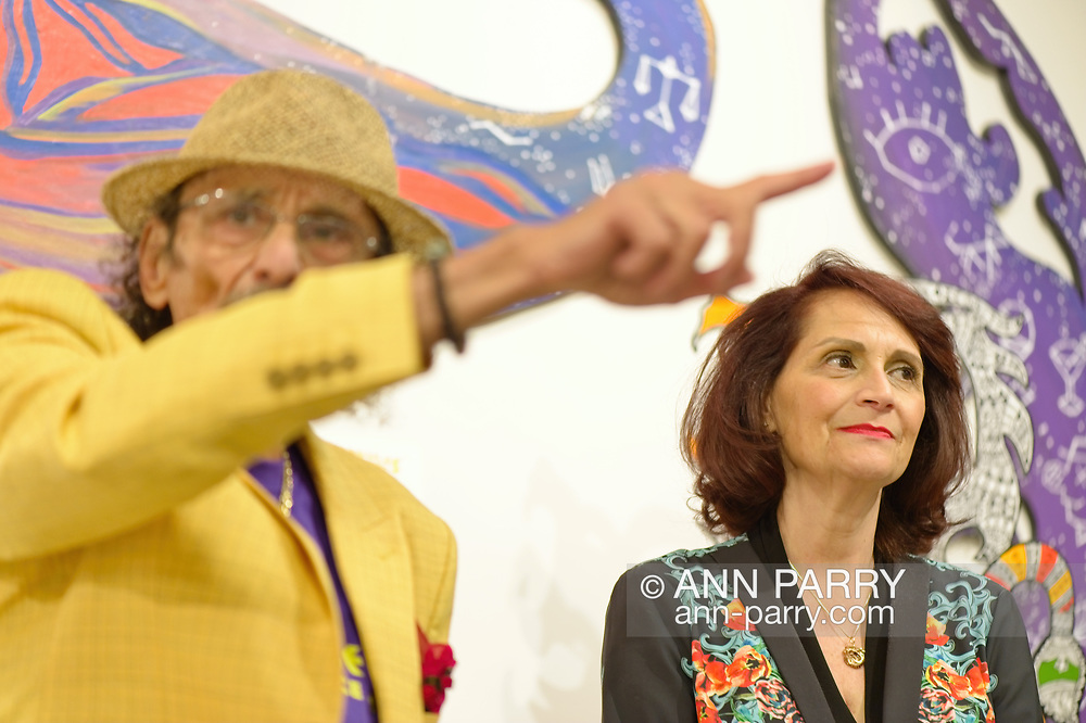 Roslyn, New York, U.S. September 13, 2019. L-R, GARY BARAT and CHANDRI BARAT speak at ANIMODULES Agents of Peace exhibit Farewell Reception and Founders' talk at the Nassau County Museum of Art's Manes Art & Education Center, named for Dr. Harvey Manes, who was in attendance and spearheaded the exhibit.