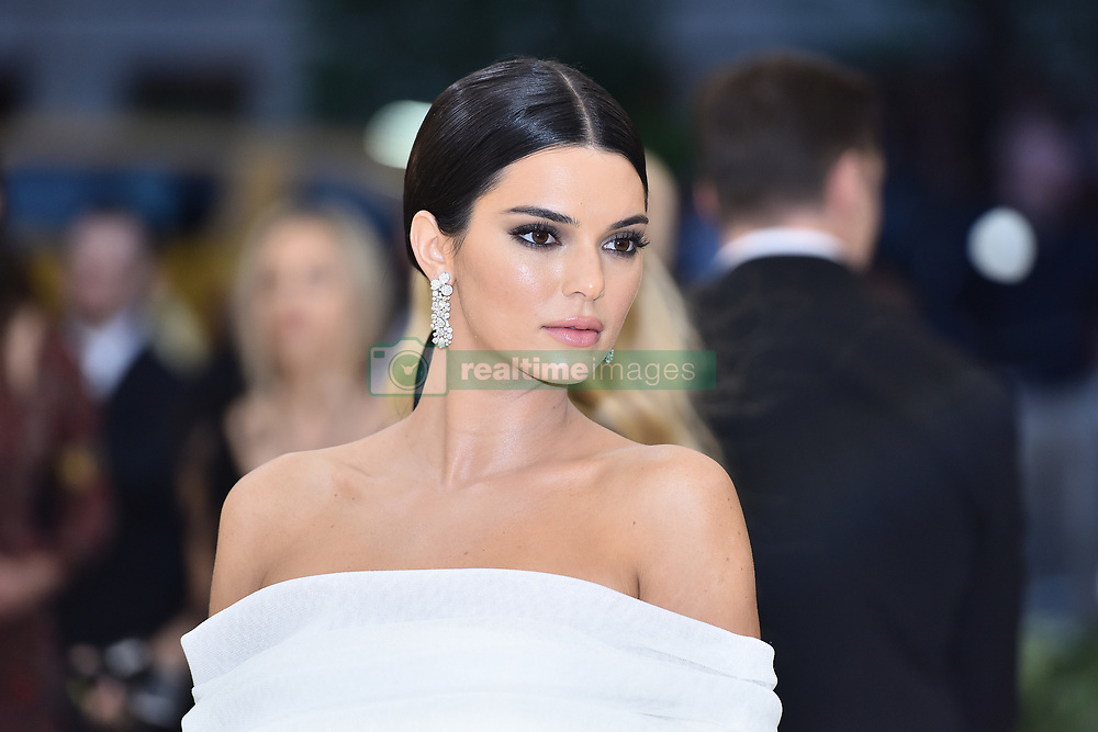 Kendall Jenner walking the red carpet at The Metropolitan Museum of Art Costume Institute Benefit celebrating the opening of Heavenly Bodies : Fashion and the Catholic Imagination held at The Metropolitan Museum of Art  in New York, NY, on May 7, 2018. (Photo by Anthony Behar/Sipa USA)