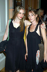 Left to right, MISS DAISY DE VILLENEUVE and her sister MISS POPPY DE VILLENEUVE at a party hosted by Dom Perignon and Vanity Fair magazine to celebrate the launch of a unique collection of essays based on the theme of seduction to raise money for the charity English Pen. The paty was held at the Dom Perignon Mallroom,  13 Grosvenor Crescent, London W1 on 8th September 2004.