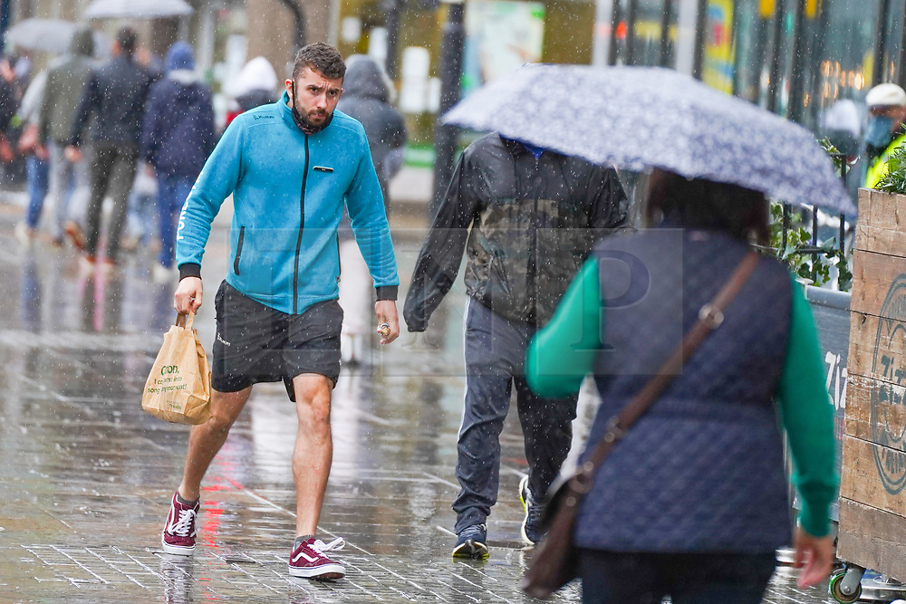 © Licensed to London News Pictures. 28/08/2020. Manchester. A man tries to find a cover during  heavy rainfall this morning in Manchester. Photo credit: Ioannis Alexopoulos/LNP