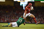 Tyler Morgan of Wales is tackled by Ireland's Keith Earls. Wales v Ireland rugby union international, RWC warm up friendly match at the Millennium Stadium in Cardiff, South Wales on Saturday 8th August  2015.<br /> pic by Andrew Orchard, Andrew Orchard sports photography.