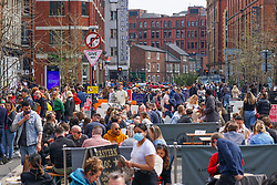 © Licensed to London News Pictures. 17/04/2021. Manchester, UK. Members of the public enjoy a drink in Manchester City centre after lockdown restrictions were eased. Photo credit:  Ioannis Alexopoulos/LNP