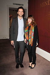 ANNIE MORRIS and IDRIS KHAN at the Krug Mindshare auction held at Sotheby's, New Bond Street, London on 1st November 2010.
