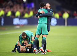 Tottenham Hotspur's Son Heung-min (centre) and Harry Kane (right) celebrate with team-mates after the final whistle during the UEFA Champions League Semi Final, second leg match at Johan Cruijff ArenA, Amsterdam.