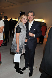 """CHARLES & AGNIESZKA BUTTER at the launch of """"Photo-Me by Starck"""" – a photobooth exclusively designed by the world renowned artist and creator Philippe Starck held at The Saatchi Gallery, Duke Of York Square, Kings Road, London on 2nd November 2011."""
